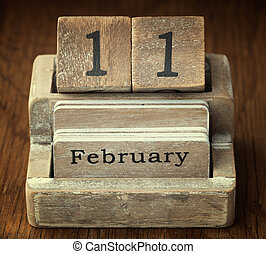A very old wooden vintage calendar showing the date 11th...