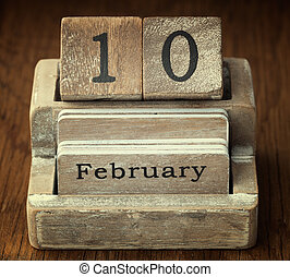 A very old wooden vintage calendar showing the date 10th Februar
