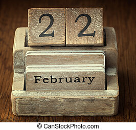 A very old wooden vintage calendar showing the date 22nd...