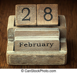 A very old wooden vintage calendar showing the date 28th...