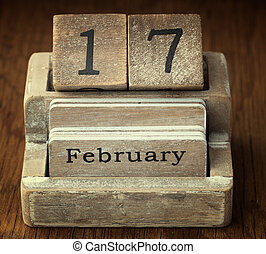 A very old wooden vintage calendar showing the date 17th...