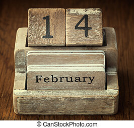 A very old wooden vintage calendar showing the date 14th...
