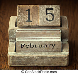 A very old wooden vintage calendar showing the date 15th...