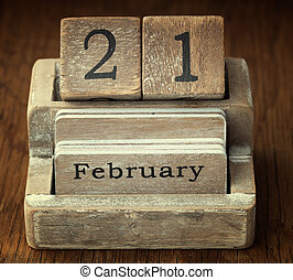 A very old wooden vintage calendar showing the date 21st...