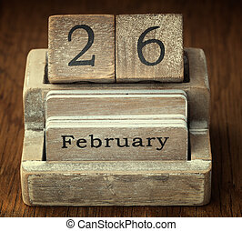 A very old wooden vintage calendar showing the date 26th...