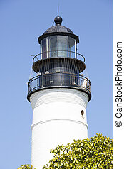 Key West Lighthouse - Close view of Key West town old...