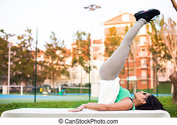 Fitness Woman - Fitness woman doing exercises in the city...