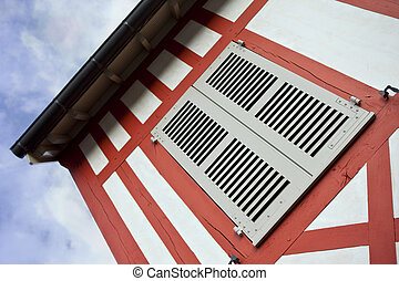 Shutter on an half timbered house in France