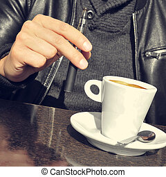 young man with an electronic cigarette and a cup of coffee...