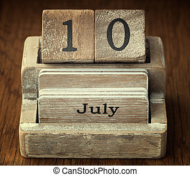 A very old wooden vintage calendar showing the date 10th July on