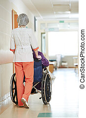Nurse with elderly patient in wheelchair