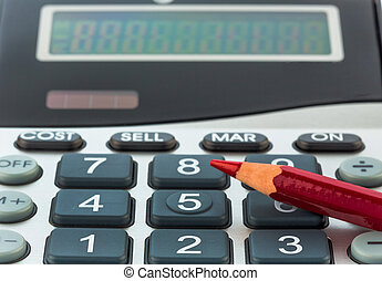 red pen and calculator - a red pen is on a calculator. save...