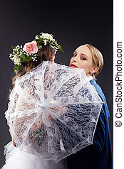 Idea of same-sex marriage. Pretty bride and groom, close-up