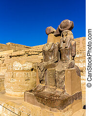 Statues of Ramses III. and Thoth at the mortuary temple -...