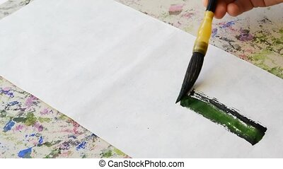 Painting green bamboo using Chinese brush made from badgers...
