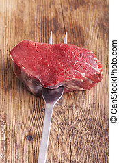 steak on a meat fork