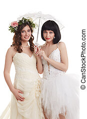 Beautiful brides. Concept of double wedding - Beautiful...