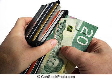 Paying Cash with Canadian Currency - The action of pulling...