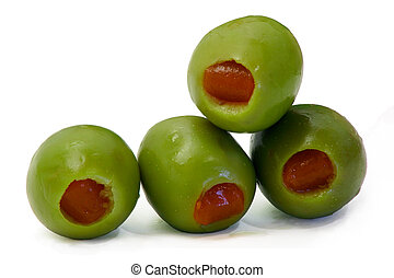 Olives - This is a close-up of four stuffed olives.