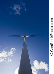 Windmill on blue sky - White windmill on blue sky with...