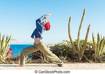 Yoga practice - Woman doing yoga asana at sea resort