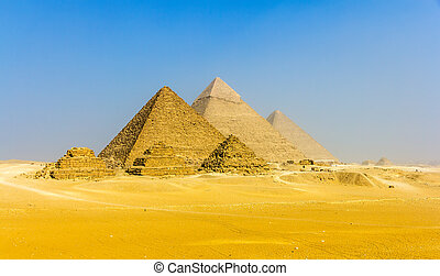 View of pyramids from the Giza Plateau: three Queens'...