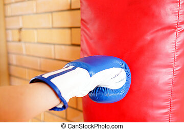 Boxing glove punch a red punching bag exercises