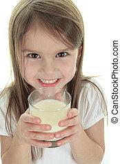 Little girl drinking milk on white background. Studio shot
