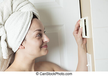 Woman shower thermostat - A woman in shower rise up...