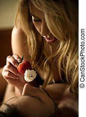 Strawberry with whipped cream - Sexy woman feeding man with...