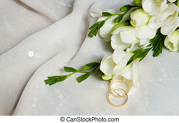 Wedding card. Two golden rings with bridal veil and flowers