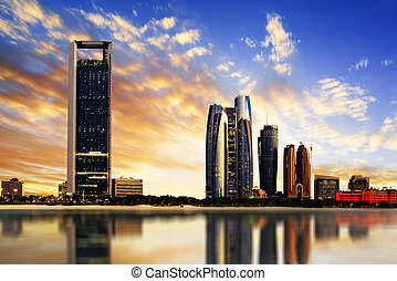 Abu Dhabi Skyline - Panorama of Abu Dhabi at night, capital...