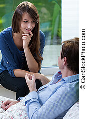 Conversation with patient - Young attractive nurse having...