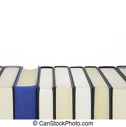 Group of books and one book standing out from others with spine