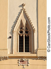 gothic window at the wall of the church