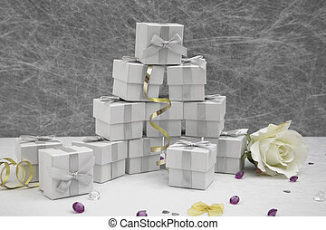 Wedding Favor boxes on a White tablecloth with gold ribbons,bows