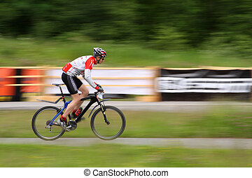 Mountain Biker in race - The Mountain Biker in race coross...