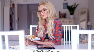 Woman Holding a Plate of Snacks While Reading - Close up...