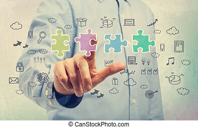 Businessman with piece of the puzzle with business ideas