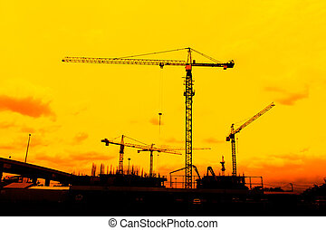 Construction site crane silhouettes