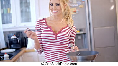 Sexy vivacious woman making the dinner posing in the kitchen...