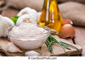 Fresh made Aioli (Garlic dip) on wooden background