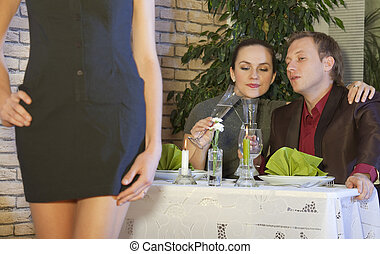 horny man in restaurant - man looking at a nice girl passing...