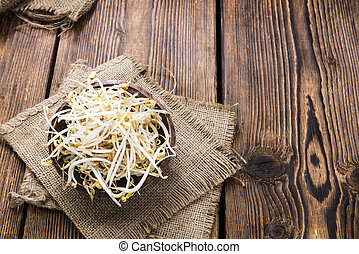 Mungbean Sprouts (close-up shot) on wooden background