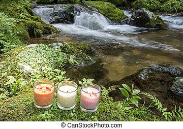 Three candles at riverside