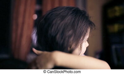 Teen girl child straightens hair combs her hair brunette...