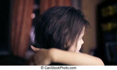 Teen girl child straightens hair combs her hair brunette...