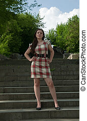 girl in short dress - A woman in short dress standing on a...
