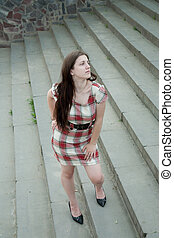 woman in short dress - elegant girl in short dress standing...