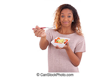 African American woman eating salad, isolated on white backgroun